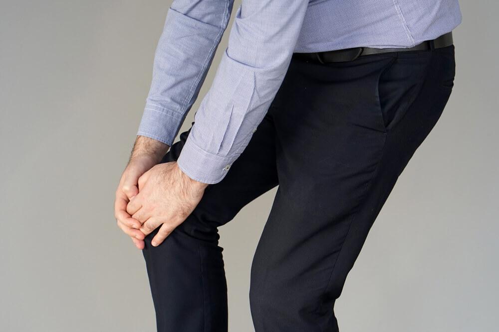 knee hugging position